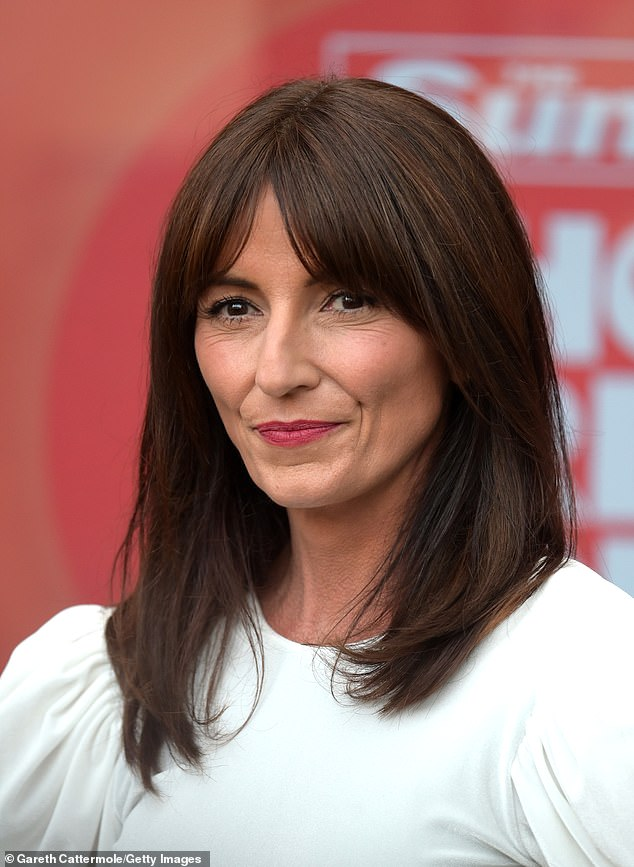 Davina McCall has said that 'she had a hard time not solving it herself at first' has said Sarah Harding's death from breast cancer was the 'sadest thing'... as she stood up to cancer (pictured) in) 2021)