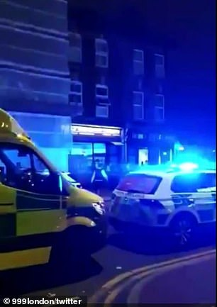 Police attended with London Ambulance Service (pictured) paramedics and found three men with gunshot wounds. One also had stab injuries