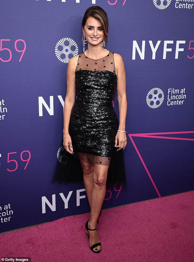 Back in black: Penélope Cruz, 47, looked effortlessly elegant in a short black dress covered with sequins as she walked the red carpet for the closing night screening of Parallel Mothers at the New York Film Festival on Friday