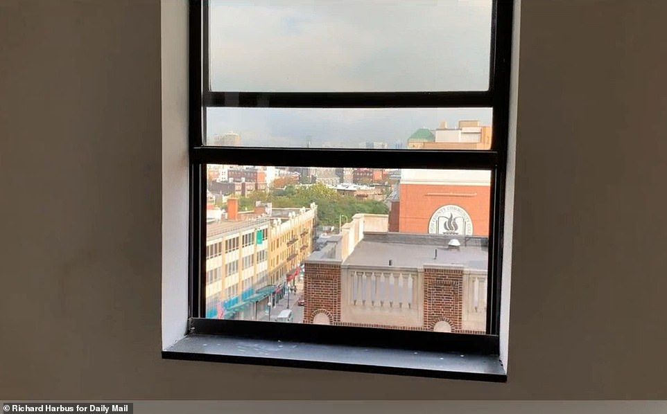 The video, taken by a Daily Mail photographer, shows the view from the ninth floor of the building at 26 Journal Square