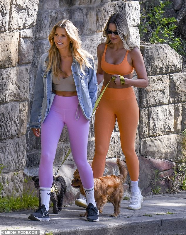 Trendy: Natalie, 31, showcased her svelte physique in a crop top teamed with bright purple leggings and a denim jacket