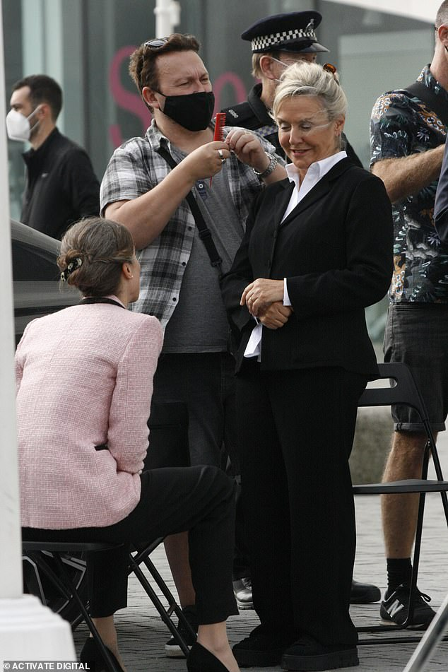 Treatment:Crew members ensured that her slicked back tresses were nothing short of perfect and Amanda looked buoyant as she engaged in conversation between takes