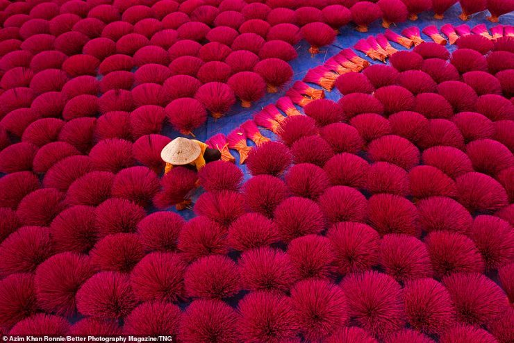 Azim Khan Ronnie also wowed judges, picking up a Silver Award in the Exotic Travel category, with this shot of Vietnamese workers surrounded by thousands of incense sticks