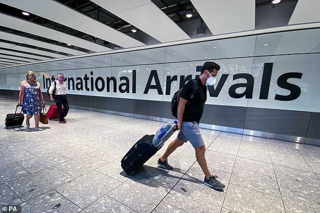 Double-vaccinated people arriving in England from 47 new countries, including South Africa, Mexico and Thailand, will no longer be required to spend 11 nights in quarantine at a cost of £2,285 per traveller. Above: Passengers arrive at Heathrow Airport, London