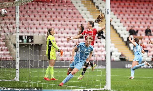 Ellen White came off the bench just before the hour to earn Manchester City a vital point