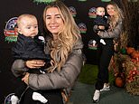 Dani Dyer dons a brown puffer jacket as she cuddles up to baby Santiago at Alton Towers Scarefest