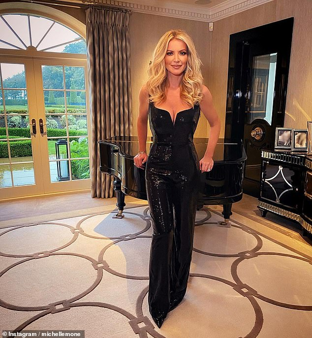 Wow!  Michelle revealed she is an expert at partying and flaunted her incredible figure in an oversized black jumpsuit as she geared up for her first big bash