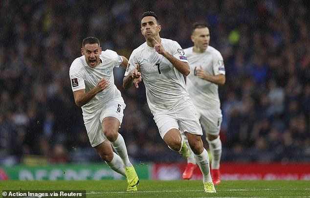The Israeli striker wheels away in celebration after making it seven goals in seven qualifiers
