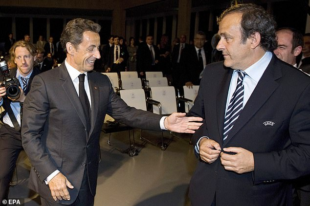 Michel Platini (R) voted for Qatar due to pressure from French president Nikolas Sarkozy (L)