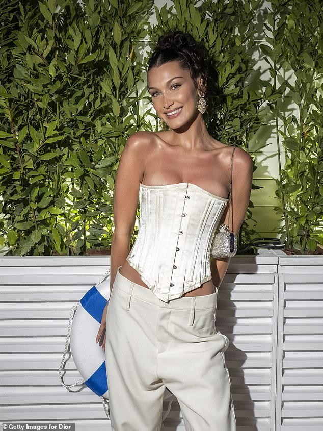 Bella Hadid turns 25! The model received gushing tributes from Vogue, Dua Lipa and other close members of her inner circle as she celebrated with Palestinian food with her family; pictured July 2021