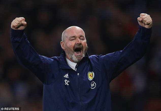 Steve Clarke lets out a scream of jubilation after his side secured a huge three points