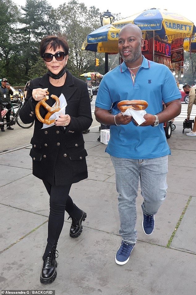 Snack time: Kris Jenner enjoyed a pretzel with boyfriend Corey Gamble while strolling through the park in New York on Saturday morning