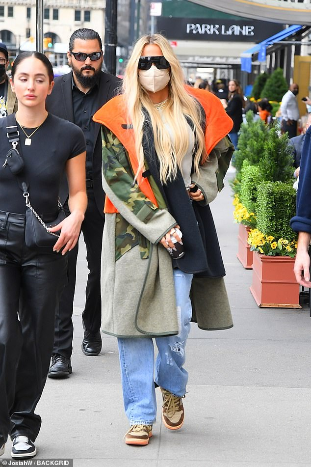 Classic: After indulging in a quick snack, Kris and Corey met up with Khloe, who rocked a camouflaged coat with jeans and brown Nike trainers