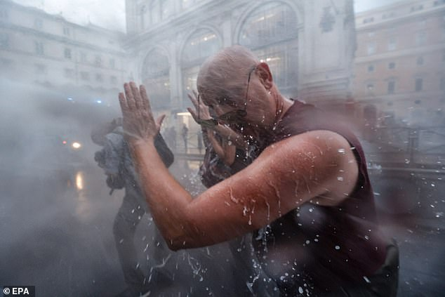 In Rome, thousands of demonstrators marched down Rome's Via Veneto and other main streets on Saturday, but were blasted with water cannons used by police officers
