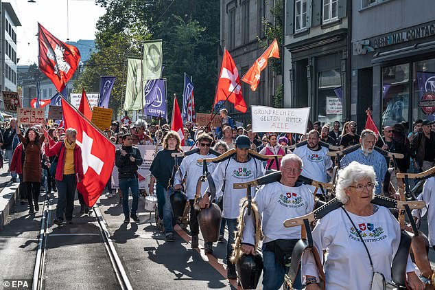 SWITZERLAND:Protesters and members of the 'Freiheitstrychler' group during a demonstration against civil restrictions and the coronavirus vaccine in Basel