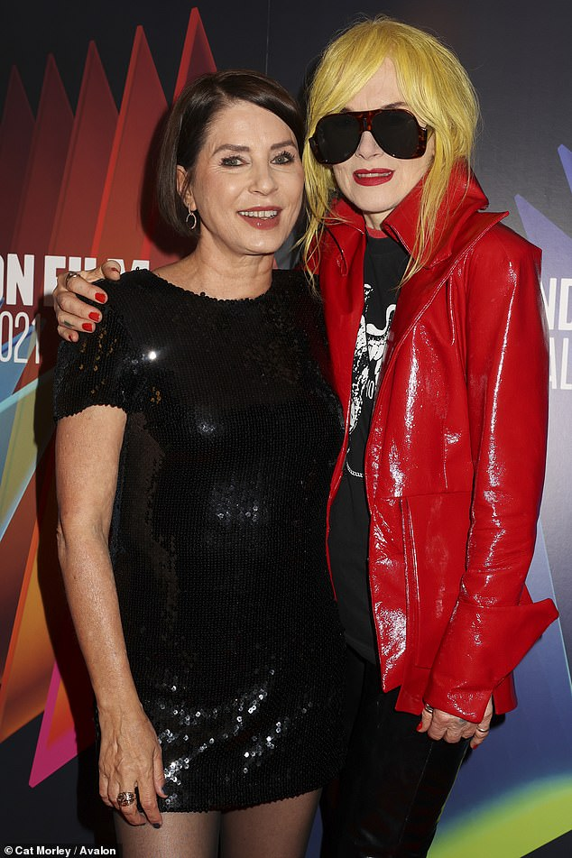 Wow!  Pam (right) layered a show-stopping number over a black T-shirt and dyed her luscious locks a neon shade of yellow