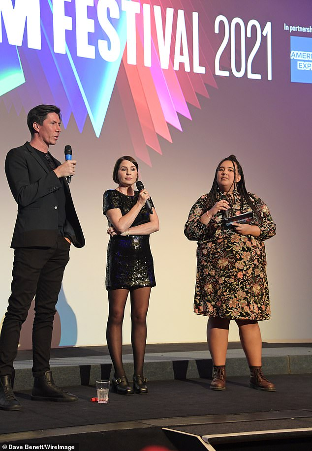 Team: Sadie stood on stage with Ben and Grace Barber-Plenty as they talked about their project with the audience
