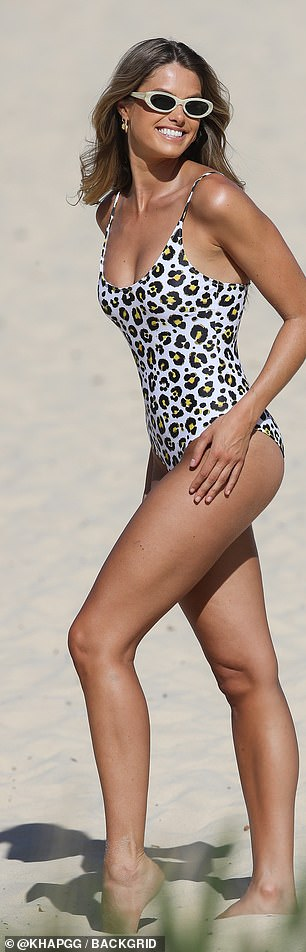 Natalie showed off her trim pins in a leopard print swimsuit