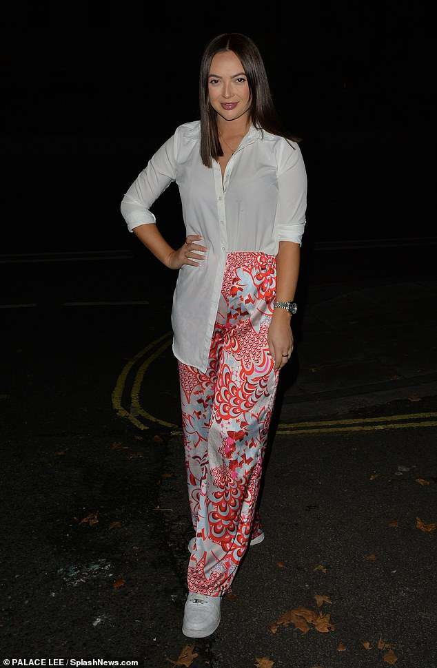 Emerging:Love Island's Sharon Gaffka looked typically chic in a white shirt and red floral trousers as she stepped out in London for a fun-filled Saturday night