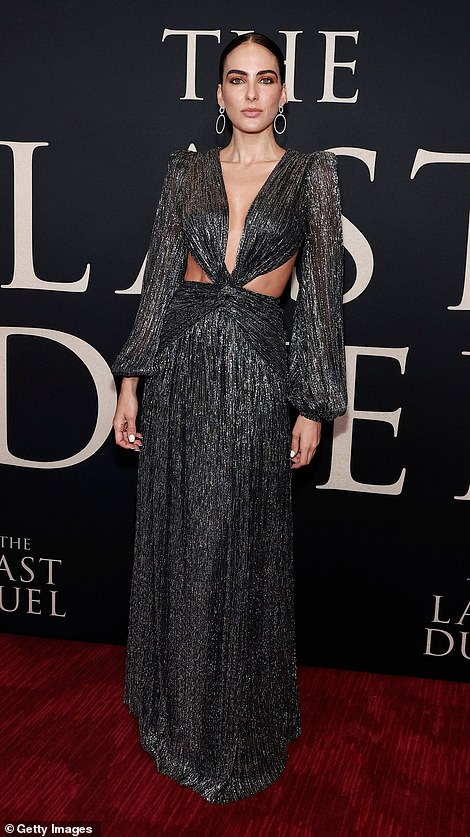Gleaming: The actress Daniela Botero shimmered in a lustrous ruched charcoal dress with a plunging neckline that tied around her taut midriff