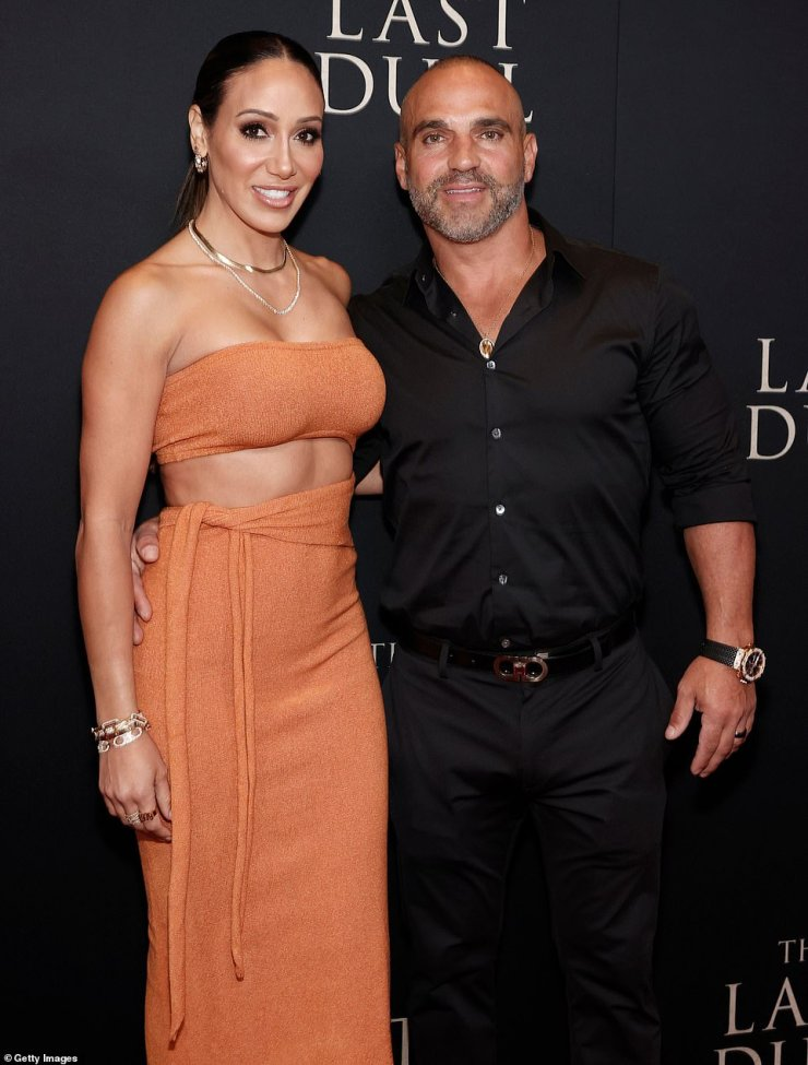 Showing off:The off-the-shoulder outfit featured a bandeau-like strip over her bust and slime skirt, which she paired with open-toe heels and a dark ponytail. Her husband Joe Gorga wore a simple black shirt with rolled-up sleeves and matching pants