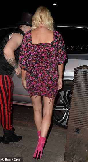 Hot to trot: The performer showcased her enviable toned legs as she left her residency at Proud