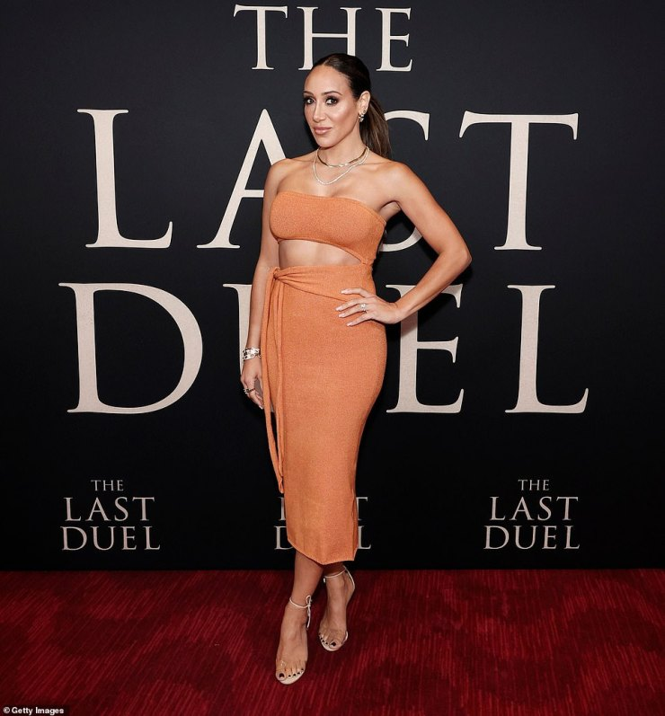 Colorful:The Real Housewives Of New Jersey star inject some color into the relatively monochrome proceedings with a striking orange dress with a triangular cutout exposing her toned tummy