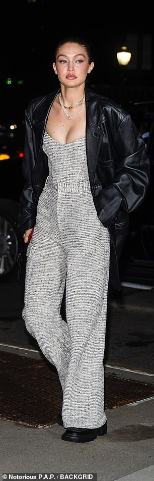 Meow: Gigi opted for a black and white-patterned jumpsuit and black boots