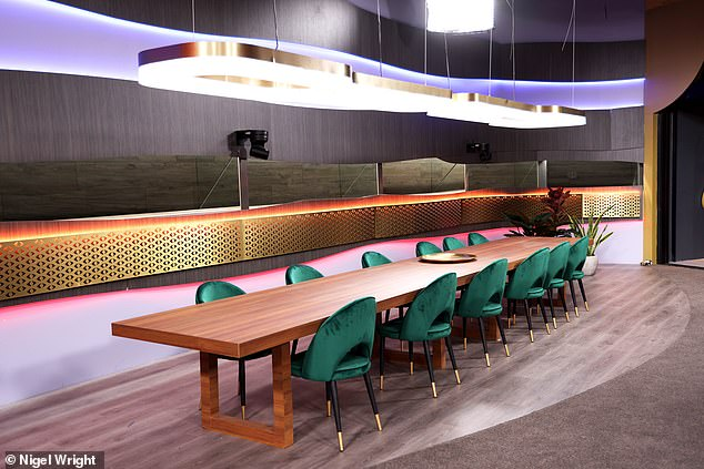 Contemporary: The dining area is contemporary with modern wood furniture and plush forest green velvet seating