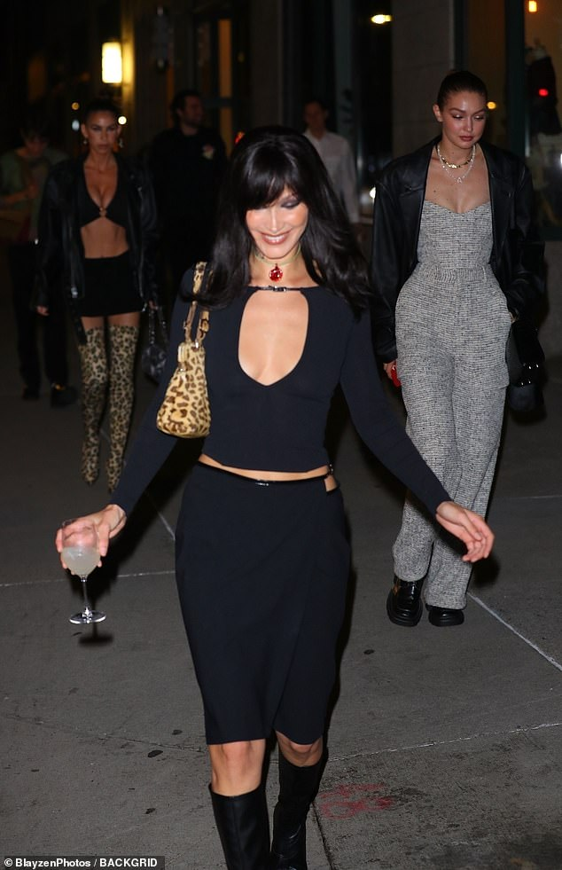 Glowing: The top model flashed a big beaming smile when she stepped out on to the street