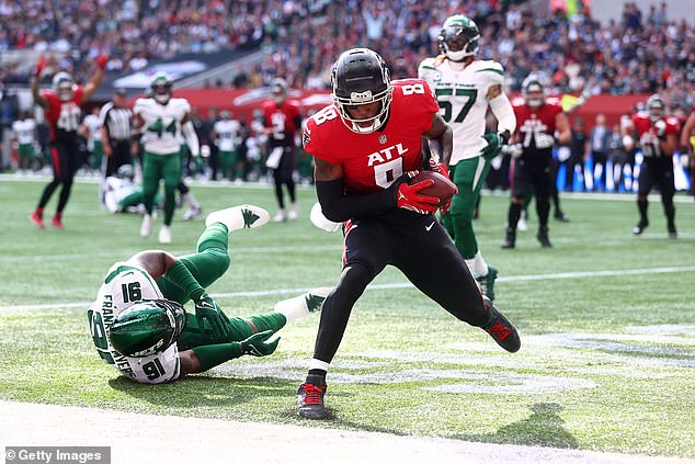 Atlanta Falcons' Kyle Pitts (right) had a long day scoring his first touchdown (above)