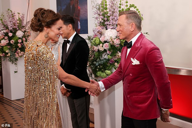 Looking good! The Duchess of Cambridge appeared just as impressed with Daniel's pink suit as he was with her show-stopping gown