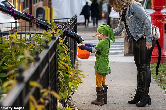 Fauci did not offer face covering guidance for trick-or-treaters (pictured here in a 2020 photo)