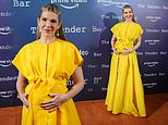 Pregnant Lily Rabe cradles her growing bump in an elegant yellow gown