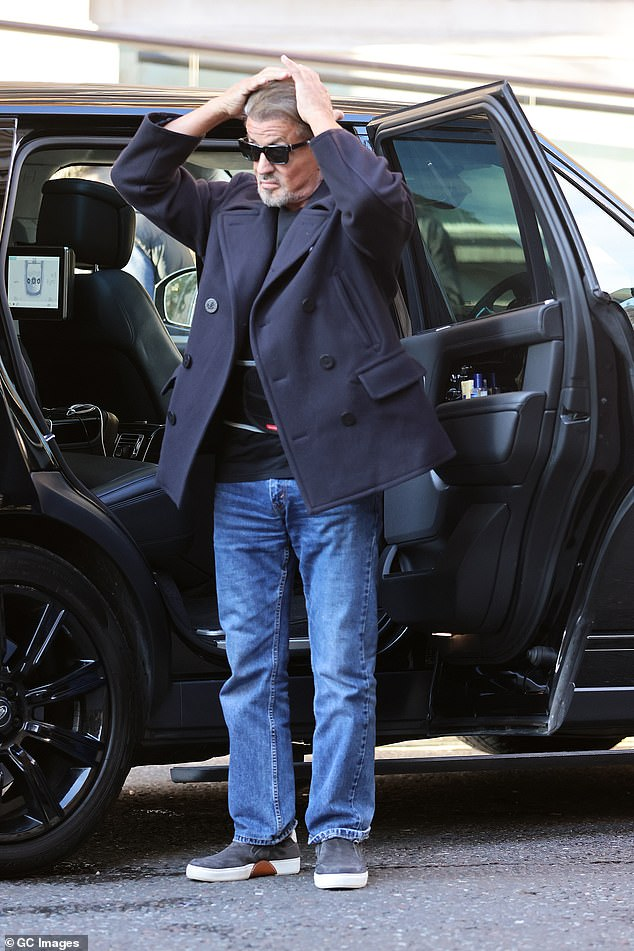 Stressed? After stepping out of a black Range Rover the actor threw his hands up to his head