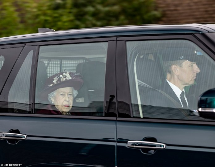 Pictured: Earlier today, the Queen was pictured being driven to a public service for the first time since Covid began