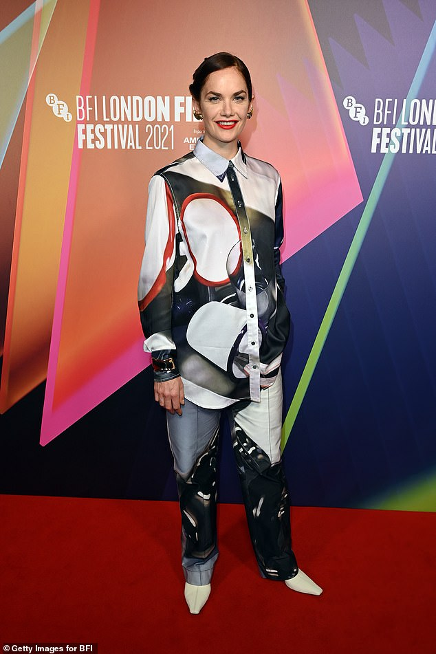 Looking good: Ruth complemented her eye-catching ensemble with white leather heeled boots