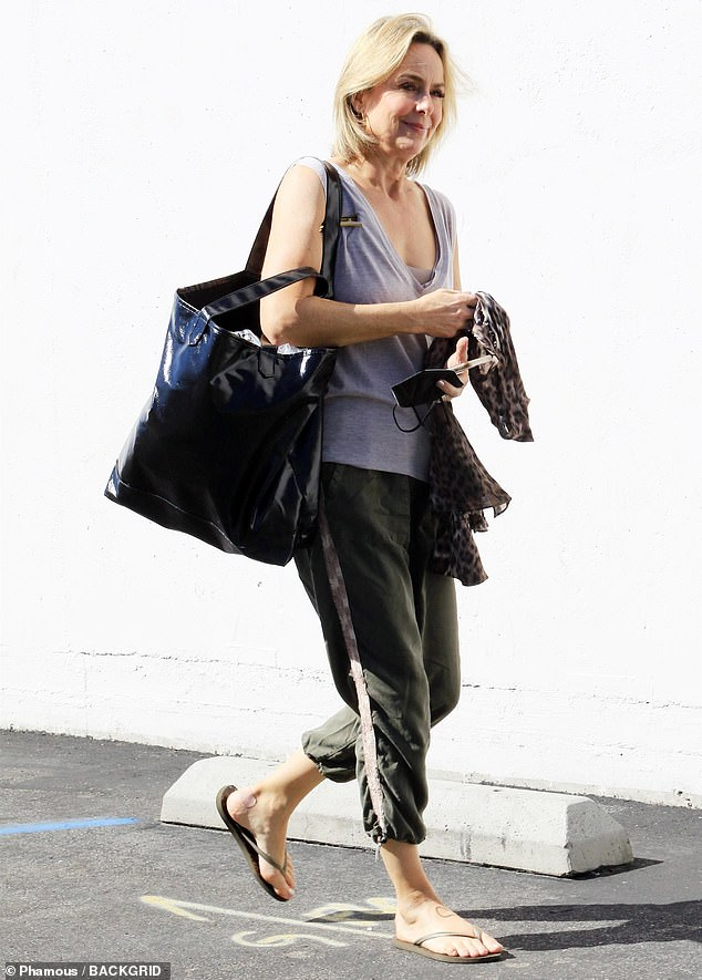 Ready for practice: Melora Hardin looked comfortable in a lilac tank top and a gray cropped sweats that had lavender stripes down the side.