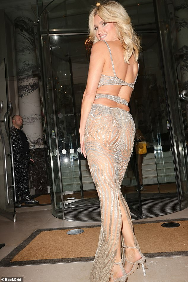 Incredible:Strutting her stuff in the sparkling number, it wasn't long before she twirled around to give photographers a cheeky peek of her peaches through the translucent material