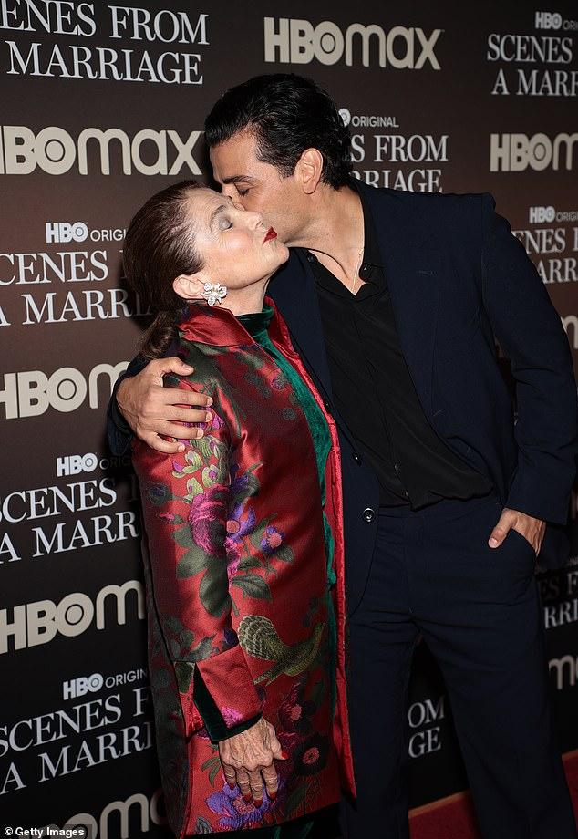 Sweet: Isaac planted a sweet kiss on Feldshuh's cheek on the red carpet