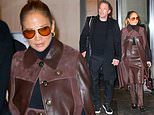 Jennifer Lopez holds hands with beau Ben Affleck as they check out of their hotel in New York