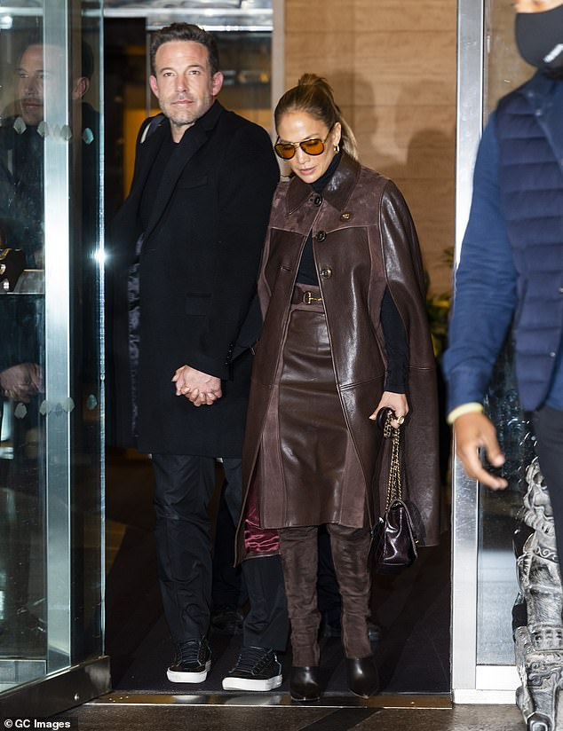 Coordinated: The Out Of Sight star paired it with a matching leather-and-suede skirt and stayed on point with ruffled thigh-high suede boots