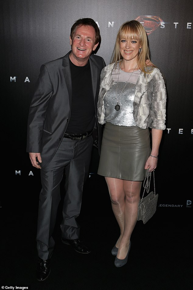 Health issues: In September 2015, it was revealed Russell had undergone emergency surgery for a brain aneurysm. Pictured at the Man of Steel premiere with his late partner, Rochelle Nolan, in Sydney in June 2013