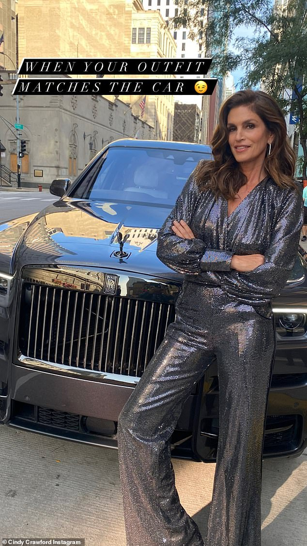 Supermodel stance: Cindy Crawford, 55, slipped into a sequin jumpsuit over the weekend to help raise money for The American Family Children's Hospital in Madison, Wisconsin