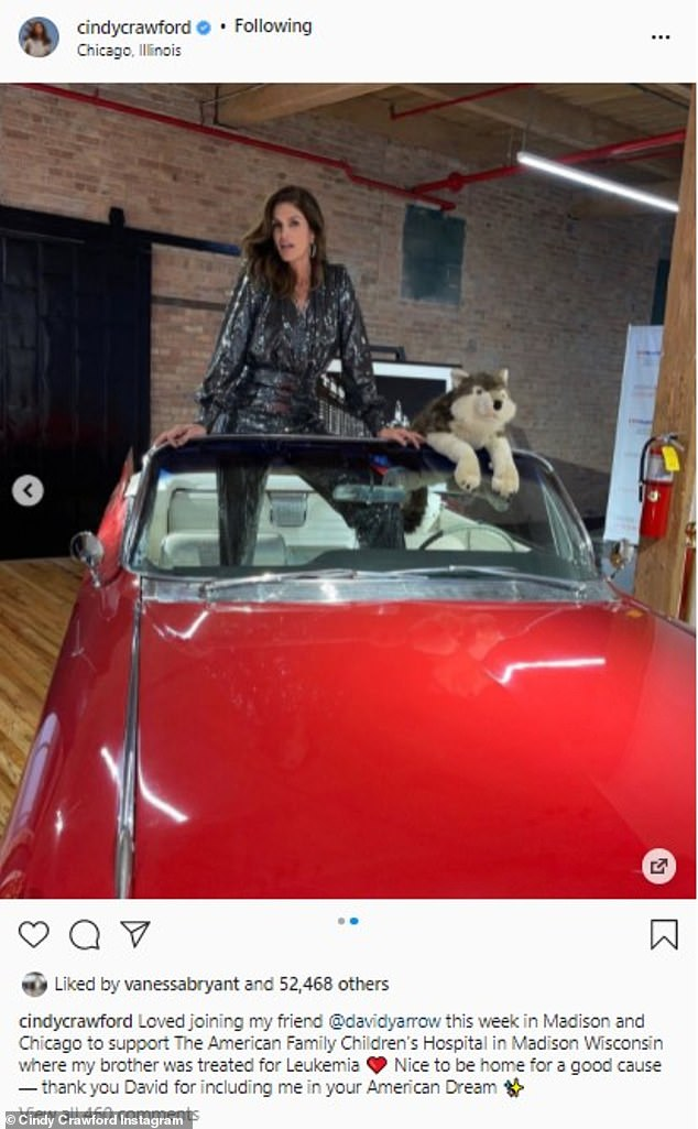 Classics: Crawford also struck a pose while standing inside a vintage red convertible car