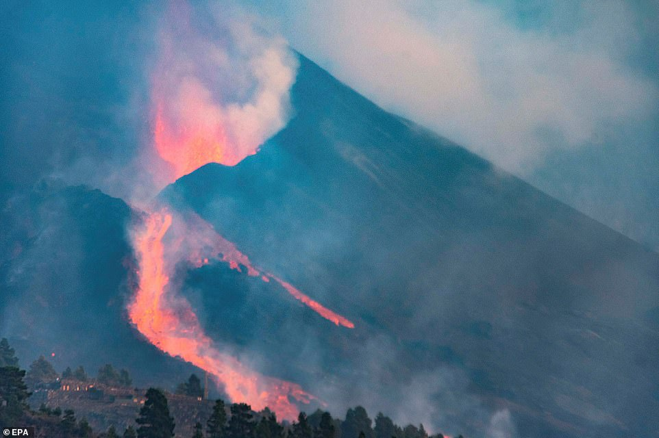 The release of large blocks of lava and formation of new lava streams down the ridge of the Cumbre Vieja volcano was caused by the northern side of the volcanic cone collapsing in on itself on Saturday (pictured)