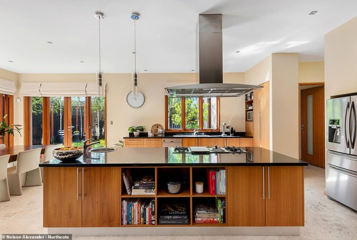 The kitchen features granite counters, a Miele dishwasher, Gaggenau cooktop with an inbuilt steamer and BBQ grill, and marble floors with underfloor heating