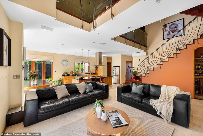 The living room in particular features exposed trusses, a glistening leadlight window combined with hand crafted lighting, hardwood floors and huge gas-log fireplace