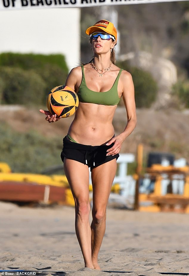 Svelte:Alessandra Ambrosio looked super fit as she engaged in a game of beach volleyball with pal Ludi Delfino on Sunday