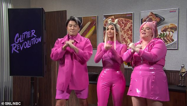 Comedy stars:She was joined by Aidy Bryant, who had a pink wig and a pink dress, and Bowen Yang, who wore an unbuttoned pink shirt over a lighter crop top and shorts